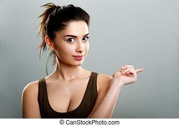 lindo, adolescente, el señalar de la mujer, dedo