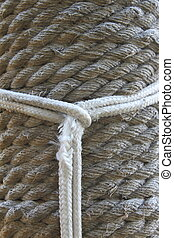 Line as a noose on the background of hemp rope.