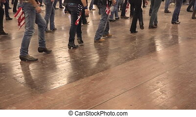 Line dance musical, dancers at old west show, country...