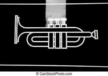 line drawing of a trumpet in black and white on glass