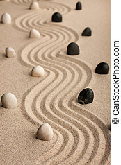 line  made of  stones standing on the sand
