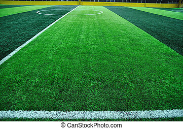 Line of artificial turf football field. - Line of artificial...