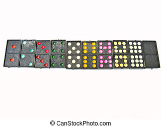 Line of black plastic domino isolated on white background