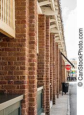 Line of Brick Columns Toward Stop Sign