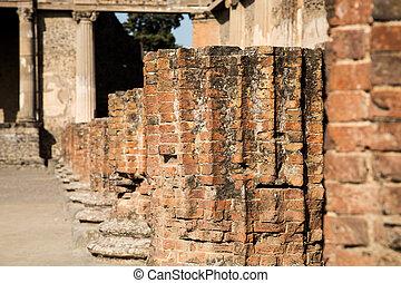 Line of Broken Brick Columns