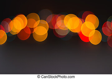 Line of colorful blurred round lights