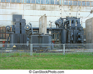 Line of huge high voltage electric converters at a power plant