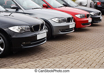 line of luxury used cars - row of prestige used cars for...