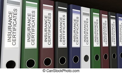 Line of multicolor office binders with Insurance...