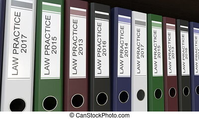 Line of multicolor office binders with Law practice tags,...
