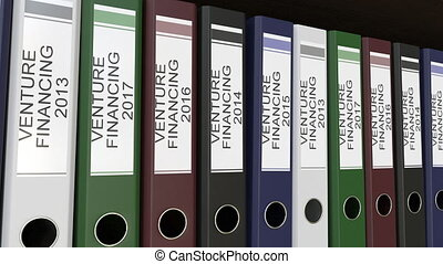 Line of multicolor office binders with Venture financing tags, different years.