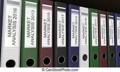 Line of multicolor office binders with Market analysis tags,...