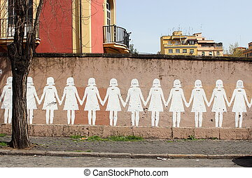 Line of paper's dolls, graffiti on Rome's wall - line of ...