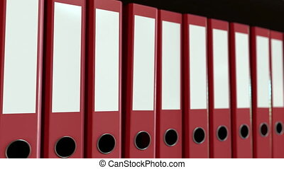 Line of red office binders. Loopable motion background