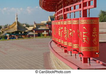 Line of red praying drums at datsan