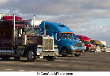 Line of Trucks 1 - Tractor-trailer trucks in a line at a...