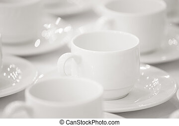 Line of white cups, on background