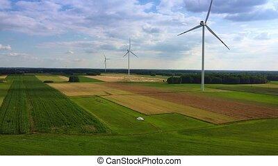 Line of wind energy turbines in summer. Aerial view
