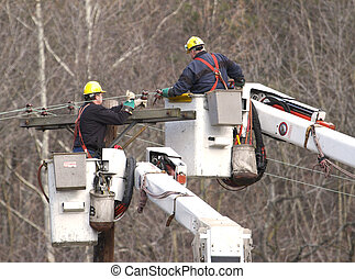 Line Workers - Men working on electrical, cable or telephone...