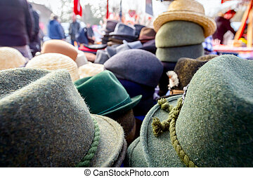 Lined male and female hats in the flea market