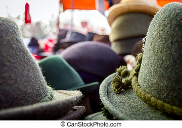 Lined male hats in the flea market