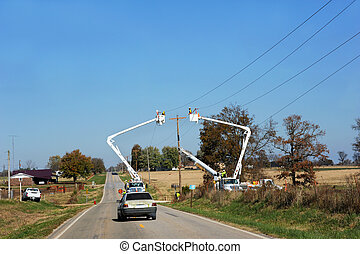 Linemen at Work on Country Road in Arkansas - Two linemen ...