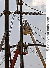 Linemen repairing high power electric lines