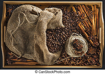 Linen bag with coffee grains, a hank of a cord, a stick of...