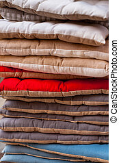 Linen chair pillows pile. Vertical outdoor shot. Natural...