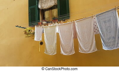 Linen Drying On The Clothesline Outside The Window In The...