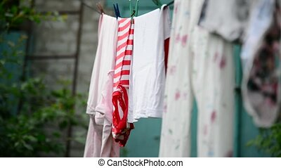 Linen is dried on rope in the garden - Linen is dried on a...