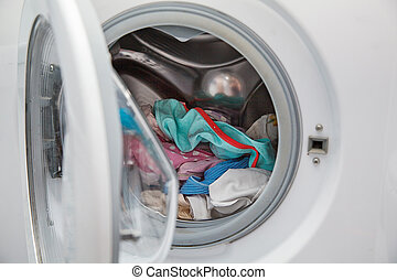 linen is loaded in the washing machine