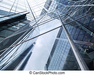 lines and sky reflecting glass facades of modern steel...