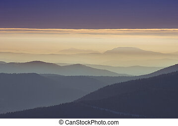 Lines of beautiful mountains in fog