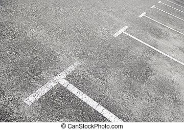 Lines on the asphalt of a parking