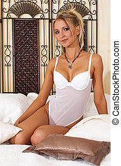 Lingerie #9 - Blonde girl sitting on bed