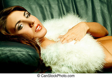 Lingerie and fur - Sexy lingerie female model on sofa