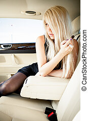 Lingerie in a luxury car - Young blond lady in sexy lingerie...