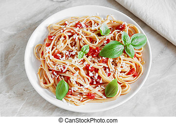 Linguine pasta in tomato sauce on a