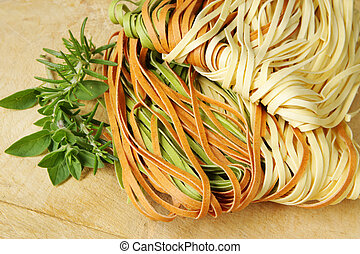Linguine - Mixed linguine egg pasta ready for cooking, with...
