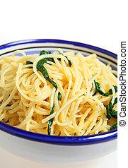 Linguine with arugula vertical - A bowl of linguine pasta...