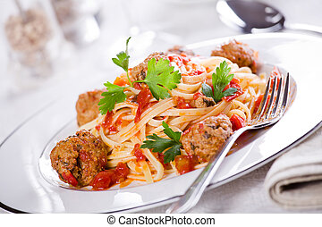 Linguine With Meatballs - Close up photograph of a tasty...