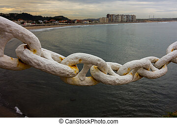 Links of a great chain anchor a boat