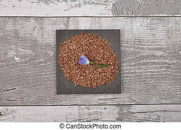 Linseed and common flax on shale and weathered wood