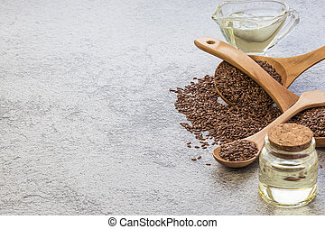 Linseed oil in a glass bottle and flaxseed vegetable source of omega-3, lowers cholesterol, used in food as a dietary salad dressing, in cosmetology, in herbal medicine