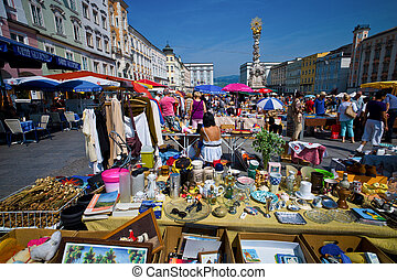 the old town in linz, austria. flea market on linz's main square