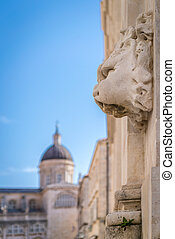 Lion face sculpture on a wall in dubrovnik