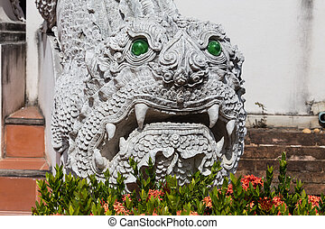 Lion guardian in front of a Chinese temple