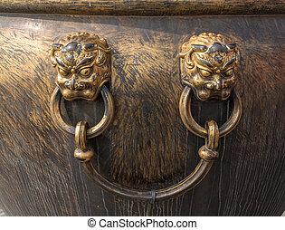 Lion handle on urn in Forbidden City in Beijing