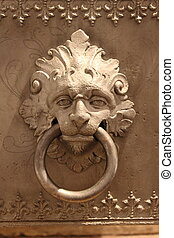 Lion head knocker - Head of marble lion holding an iron ring